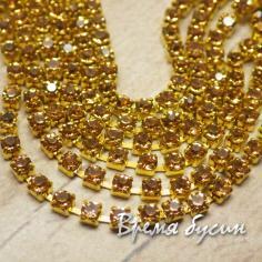 Стразовая цепь SS6. Медовый в золоте (10 см.)