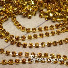 Стразовая плотная цепь SS6. Коньячный в золоте (10 см.)